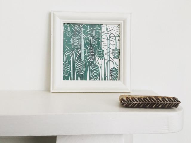 Image of multiple handmade cards lined together on a shelf.